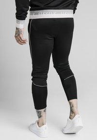 SIKSILK - DELUXE AGILITY JOGGER - Pantalones deportivos - black - 4