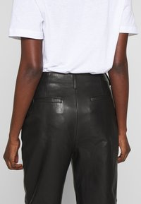 Filippa K - KARLIE TROUSER - Leather trousers - black - 5