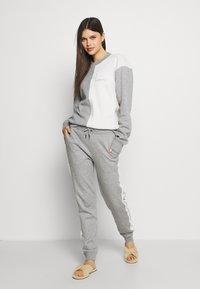 KARL LAGERFELD - LOUNGE UNISEX - Pyjama bottoms - grey melange - 1