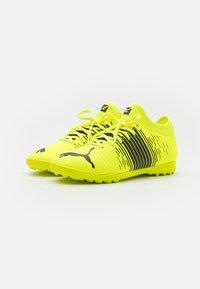 Puma - FUTURE Z 4.1 TT JR UNISEX - Astro turf trainers - yellow alert/black/white - 1