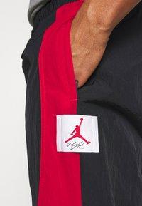 Jordan - Tracksuit bottoms - black/gym red - 4
