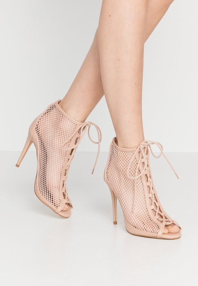 KHLOEE - High heeled ankle boots - bone