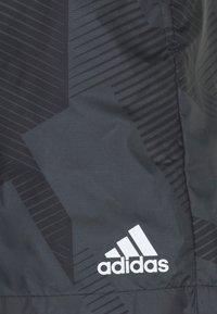 adidas Performance - GRAPHIC SEASONAL - Urheilushortsit - carbon/black - 2