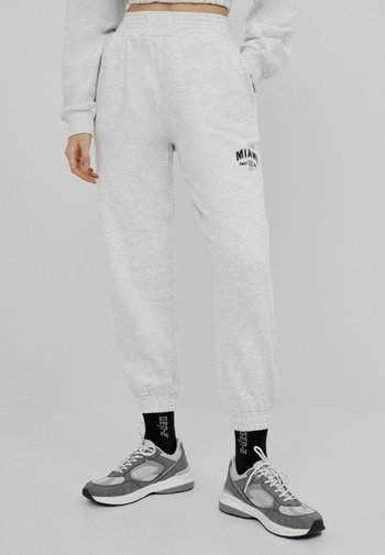 MIT PRINT - Pantalon de survêtement - grey