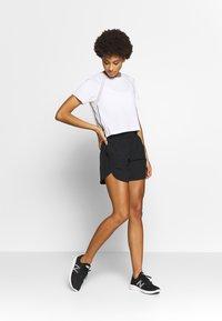 New Balance - ACCELERATE - Pantalón corto de deporte - black - 1