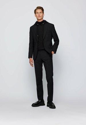Jasper/Leon - Suit trousers - black