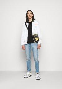 Versace Jeans Couture - PLAIN  - Polo - black - 1