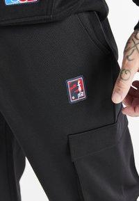 SIKSILK - SPACE JAM ELASTICATED UTILITY CARGO - Cargo trousers - black - 5