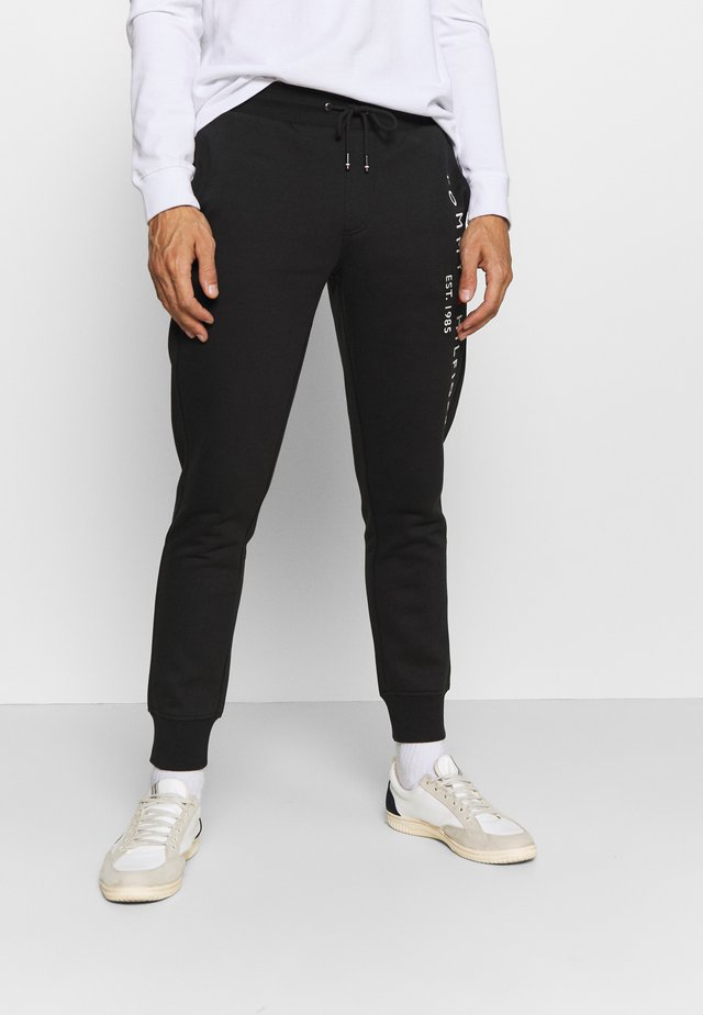 BASIC BRANDED  - Tracksuit bottoms - jet black