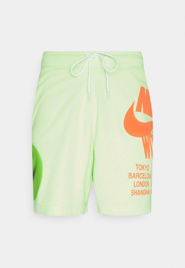 Teplákové kalhoty - light liquid lime