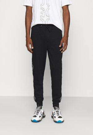 DAKY - Pantalon de survêtement - black