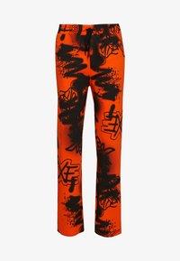 Jaded London - GRAFFITI PRINT JOGGER - Pantalones deportivos - orange/black - 0