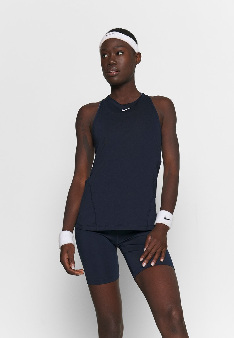 Nike Performance - TANK ALL OVER  - Sports shirt - obsidian/white