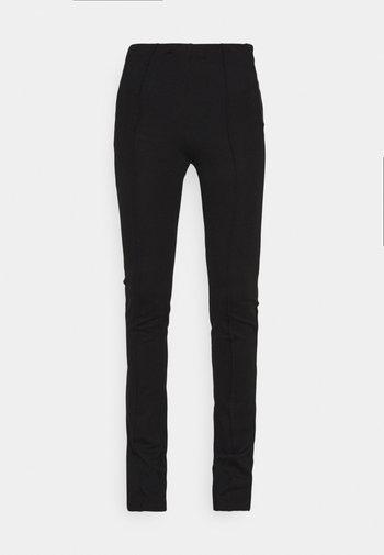 MAEVE PANTS WOMEN - Tygbyxor - black