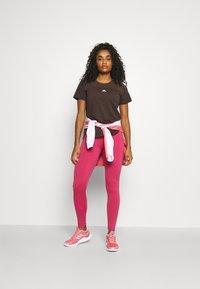 adidas Performance - AEROREADY TEE - Camiseta básica - brown - 1