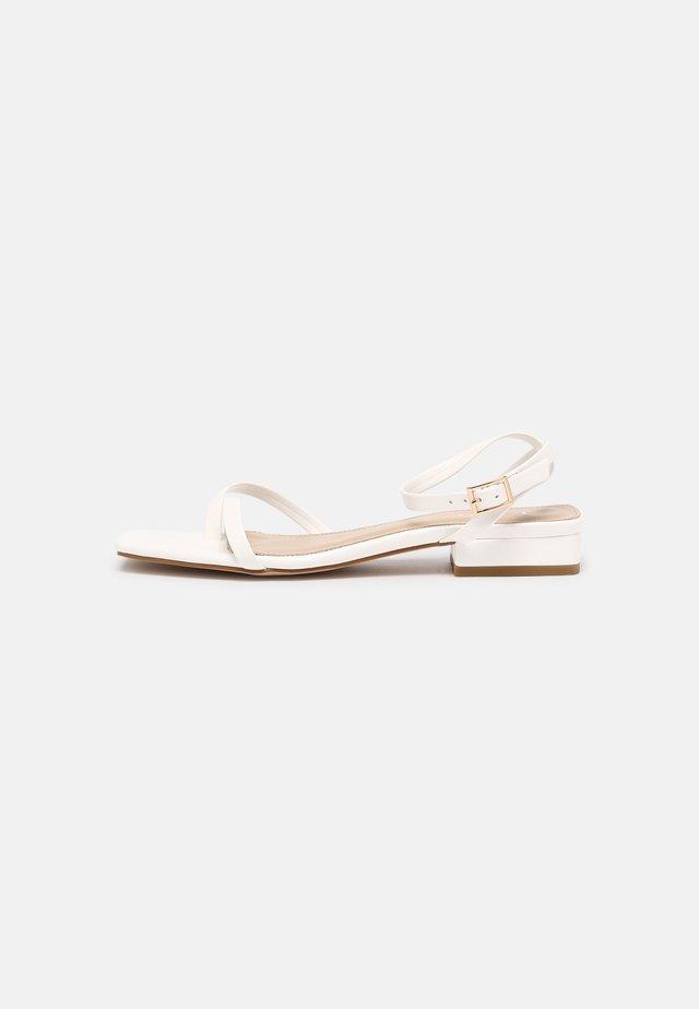 AMANI - Flip Flops - white