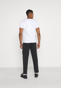Blood Brother - PALOS PARK CULOT TROUSERS UNISEX - Trousers - black - 2