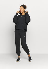 adidas by Stella McCartney - Tracksuit bottoms - black - 1