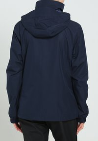 Vaude - WOMANS ESCAPE LIGHT JACKET - Waterproof jacket - eclipse - 2