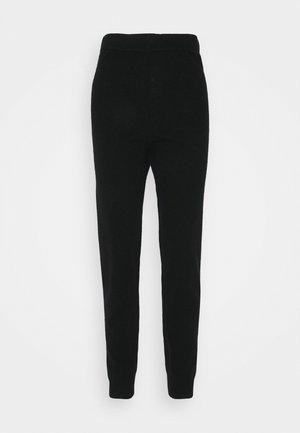 EWANDA - Tracksuit bottoms - black