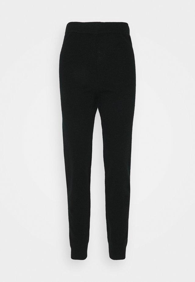 EWANDA - Pantalon de survêtement - black