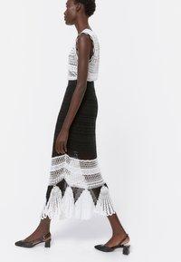 Uterqüe - A-line skirt - black - 3