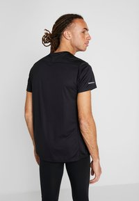 adidas Performance - OWN THE RUN TEE - Triko s potiskem - black/white - 2
