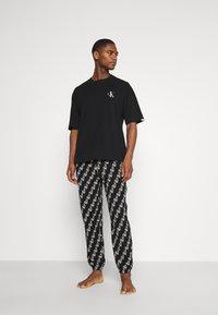 Calvin Klein Underwear - LOUNGE JOGGER - Pyjamas - black - 1