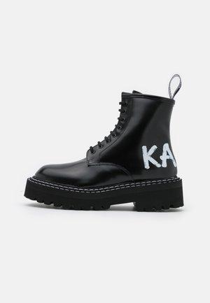 PATROL BRUSH LOGO LACE - Platform ankle boots - black
