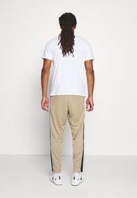 Nike Sportswear - PANT - Verryttelyhousut - khaki/black/white - 2