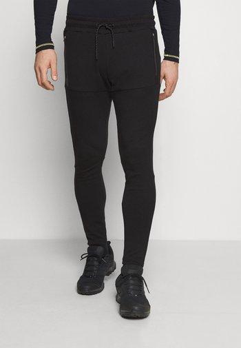 PHILLAN - Pantalon de survêtement - black