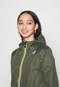 K-Way - UNISEX LE VRAI CLAUDE WARM - Waterproof jacket - black torba - 3