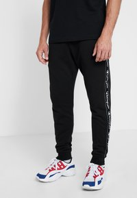 Champion - RIB CUFF PANTS - Tracksuit bottoms - black - 0