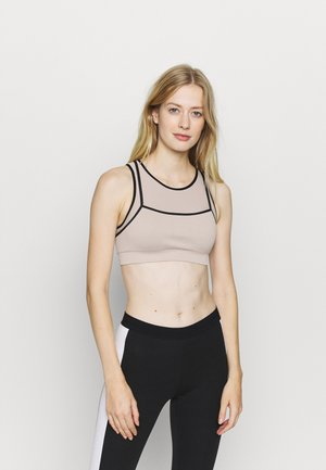 LAYERED CONTRAST SPORTS BRA - Medium support sports bra - beige