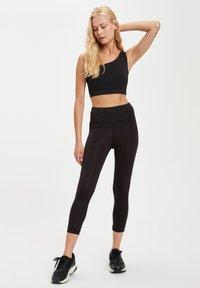 DeFacto Fit - Leggings - Trousers - black - 1