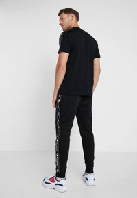 Champion - RIB CUFF PANTS - Tracksuit bottoms - black - 2