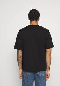New Balance - Print T-shirt - black - 2