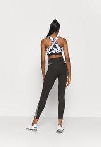 Puma - EVOSTRIPE HIGH WAIST 7/8 - Leggings - black - 2