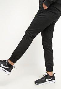 Volcom - FRICKIN SLIM FIT - Trousers - black - 3