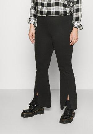 CARPEVER FLARED SLIT PANTS - Trousers - black