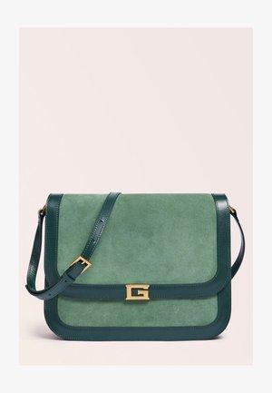THEA LUXE - Across body bag - grün