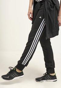adidas Performance - ESSENTIALS  - Verryttelyhousut - black/white - 3