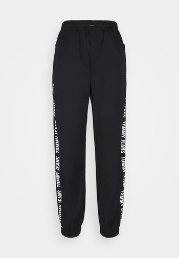 JOGGER TAPE RELAXED - Tracksuit bottoms - black