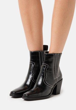 GENIVA - Kotníkové boty - black
