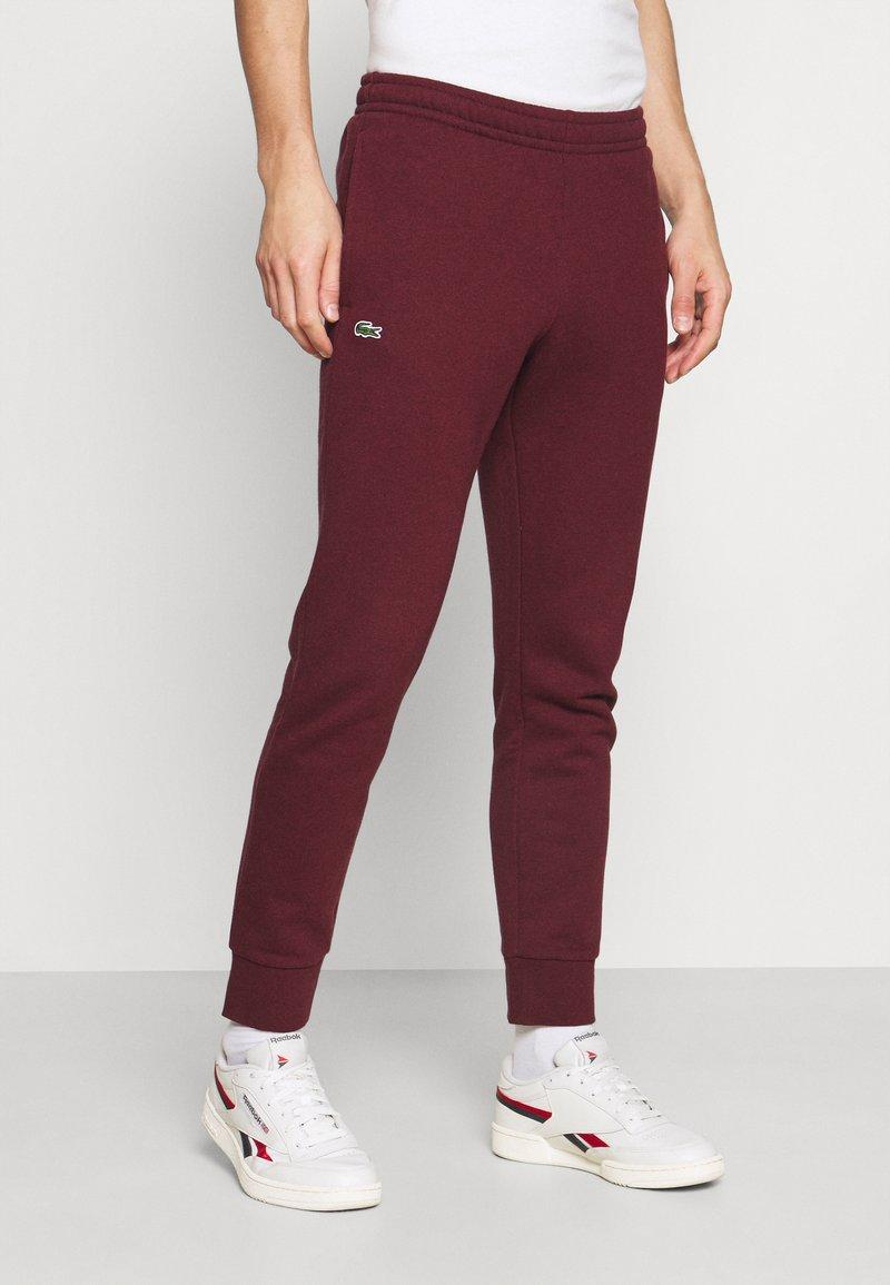 Lacoste - Spodnie treningowe - bordeaux