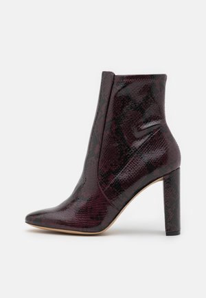 AURELLANE - Kotníkové boty - bordo