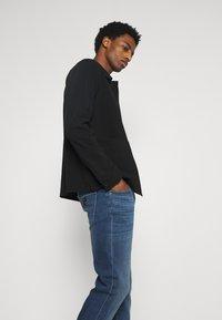 Armani Exchange - Slim fit jeans - indigo denim - 3