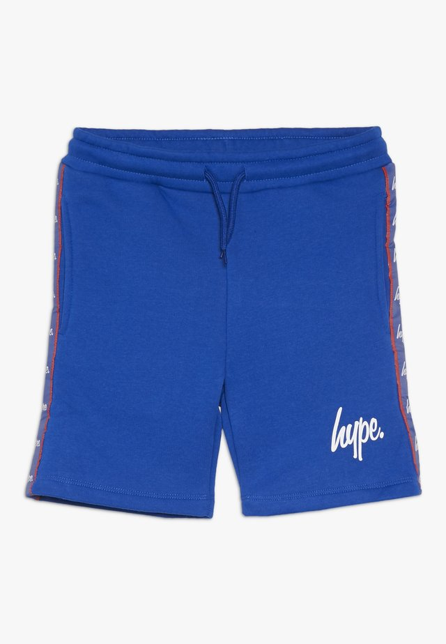 TAPED - Tracksuit bottoms - blue