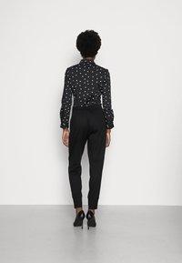 Opus - EMELA  - Trousers - black - 2