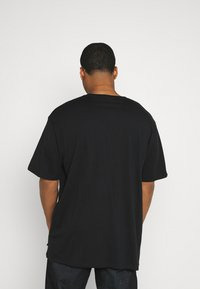 Jack´s Sportswear - CHEST EMBROIDERY TEE - Print T-shirt - black - 2